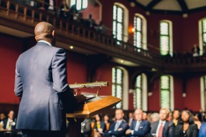 Tony Elumelu addresses the audience at the Oxford Union during the Oxford Africa Conference