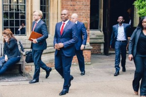 Tony Elumelu departs the Oxford Union with his team after his speech