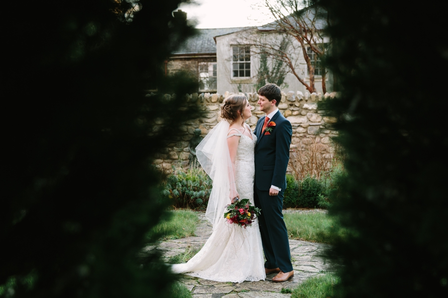 bride and groom through the trees at Seiont manor wedding