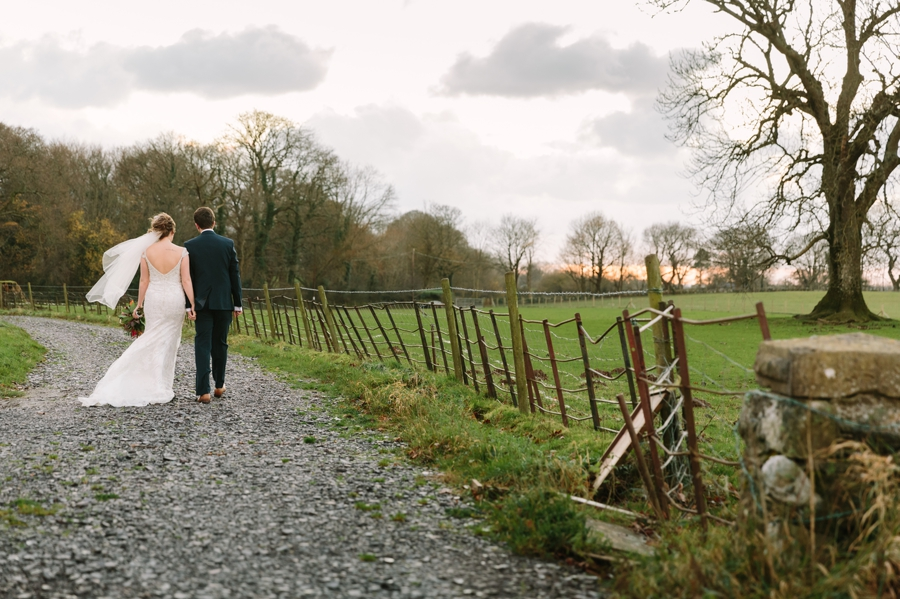 bride and groom walking down the track at Seiont manor wedding