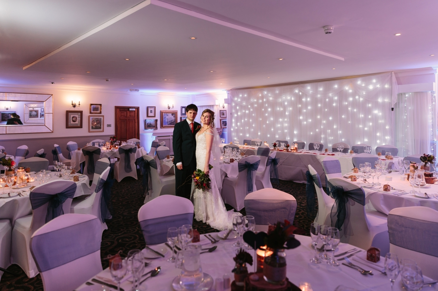 the wedding breakfast room with bride and groom at Seiont manor wedding