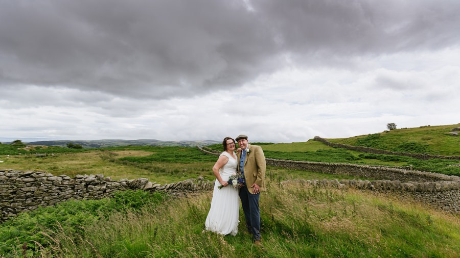 bride and groom in hills above Conwy. Get married in North Wales