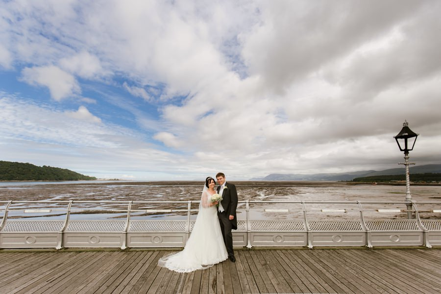 bride and groom on Bangor pier. Get married in North Wales