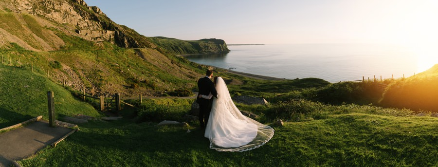 bride and groom overlook bay at Nant Gwrtheyrn. Get married in North Wales