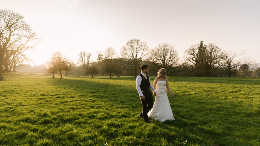 bride and groom walking in the sunset at glanusk estate