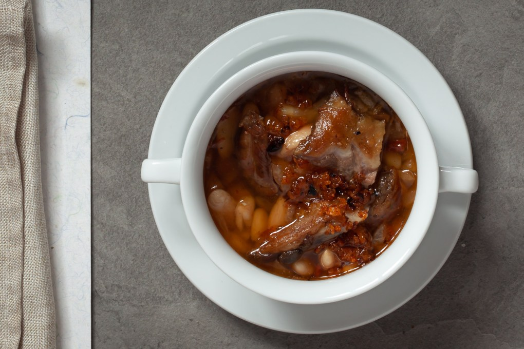 French Cassoulet in a traditional white bowl.