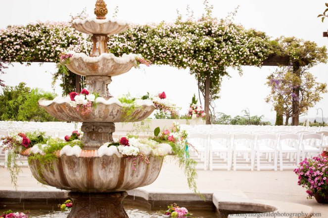 Fountain and rose arbor decorated for wedding