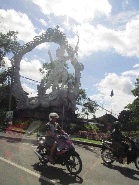 An Arjuna statue near Gianyar, as viewed from a hired car.