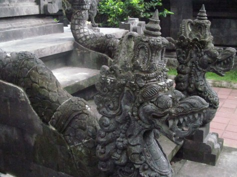 Snake deities called naga line the staircases of this temple at Goa Lawah.