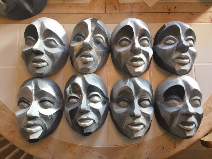 The students explored how best to paint the masks. High contrast was necessary for the sculpture to 'read' in the large dance space.