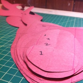 I thought topographically to create the individual pattern pieces for each layer of the stag mask.