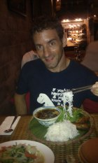 Eating Pho, a delicious noodle soup, in Hanoi
