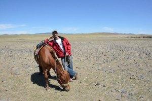 Tony leaning on horse