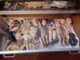 The drawer of broken dolls