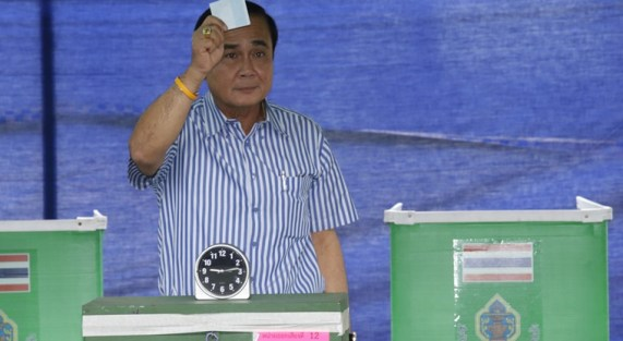 Thailand's Prime Minister Prayuth Chan-ocha poses as he casts his vote in a referendum on a new constitution at a polling station in Bangkok, Thailand, Sunday, Aug. 7, 2016. Thais voted Sunday in a referendum on a new constitution that critics say is tailor-made for the military government to stay in control for several years and entrench a new, quasi-democratic system that gives vast powers to appointed officials. (AP Photo/Sakchai Lalit)