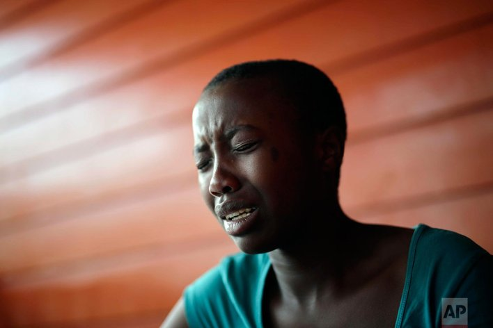 In this photo taken on Sunday, June 19, 2016, Jeannette Umutesi cries as she recalls fleeing her hometown of Kirolarwe in 2008, at the En Avant Les Enfants INUKA center in Goma, Democratic Republic of Congo. Born only a few years after Rwanda's 1994 genocide spilled into Congo and rebellions started forming, Jeannette has known only Congo's and her father's violence, displacement and death. (AP Photo/Jerome Delay)