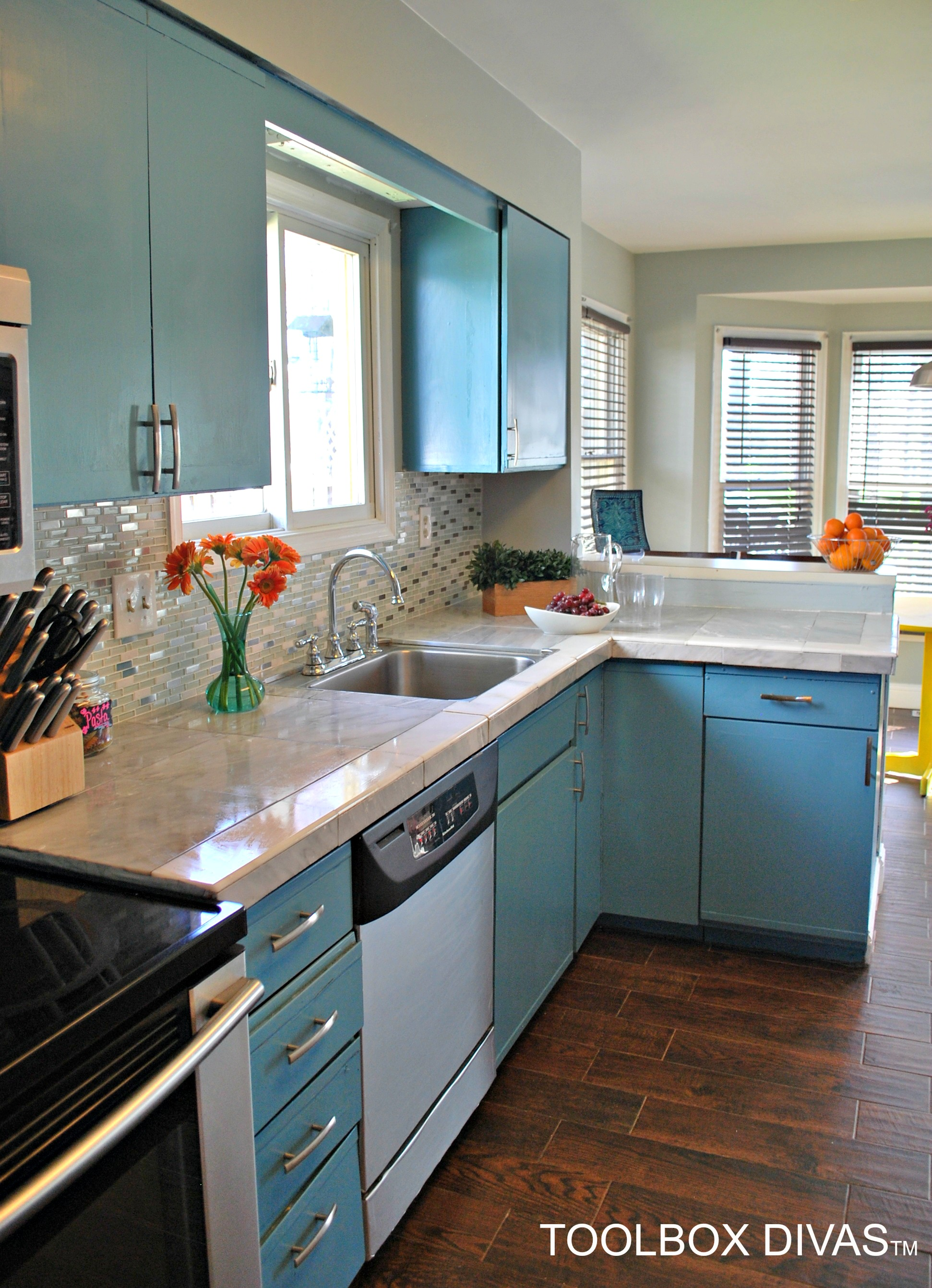 budget kitchen remodel blue cabinets and marble countertop hack chalkboard wall @ToolboxDivas