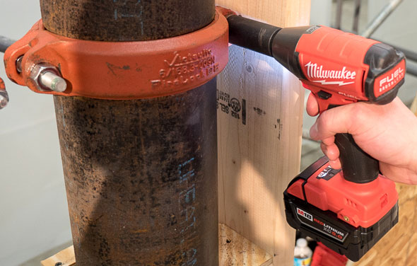Milwaukee 2755 M18 Fuel Impact Wrench in Pipe Clamp Application
