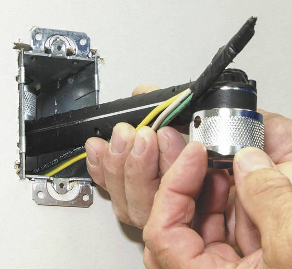 Tightening a conduit locknut with Klein wrench