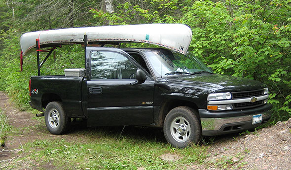 2001 Silverado carrying canoe near lake access