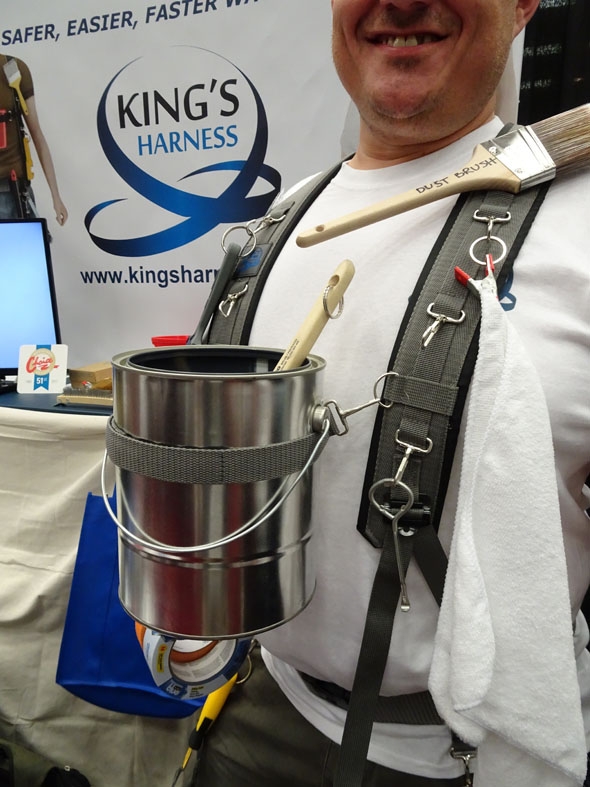 King's Harness holds a paint can