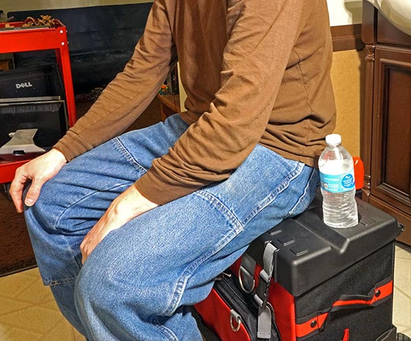 Using the Milwaukee 24 inch hardtop rolling tool bag as a seat