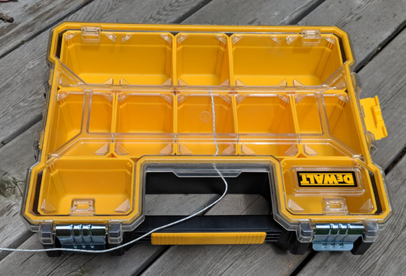 Dewalt Clear lidded organizer in the sun