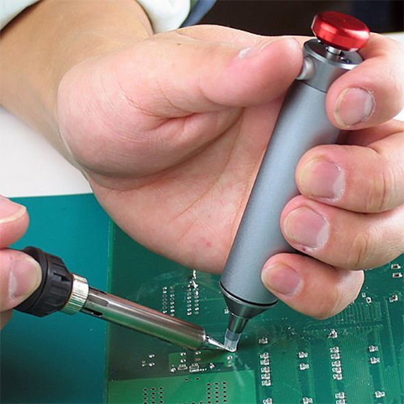 Engineer Solder Sucker Desoldering Pump in Use