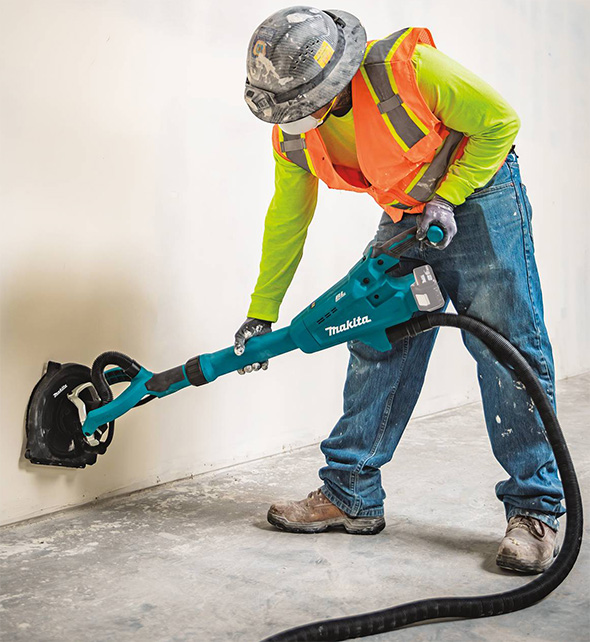 Makita XLS01 18V Cordless Drywall Sander Connected to Vacuum