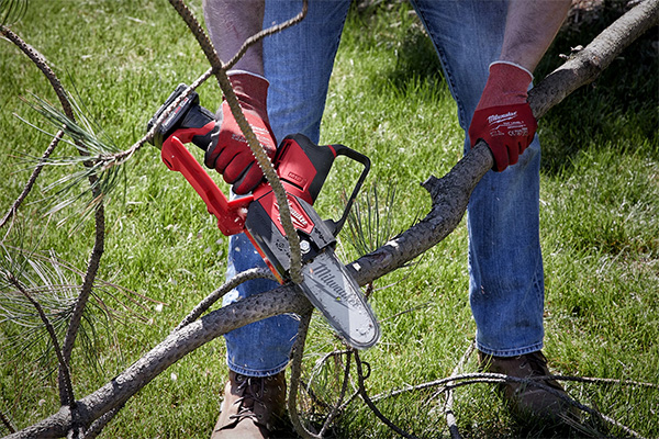 Milwaukee M12 Hatchet Chainsaw Cutting Small Branches
