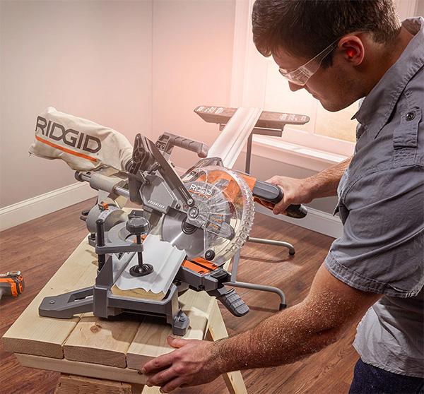 Ridgid Cordless Miter Saw R48607B Cutting Wood Trim Board