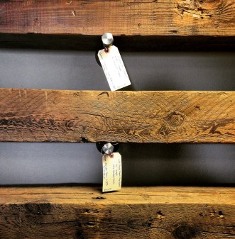 Some gorgeous mantels made from barn lumber at Sangamon Reclaimed. The tags tell customers exactly where they were sourced from and give the date of the original barn's construction.