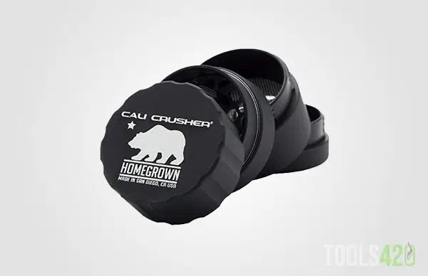 The Cali Crusher Homegrown model in its 4 layers apart displaying the to of the grinder and the branding
