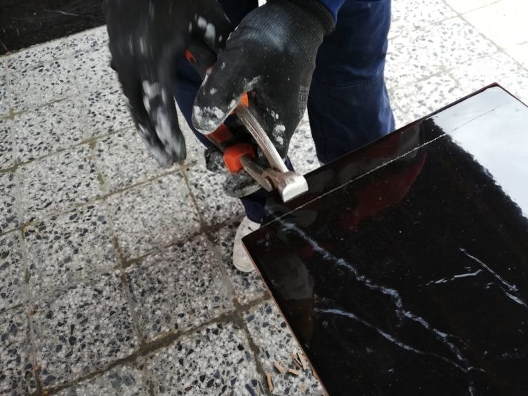 Artist breakage of ceramic tiles with pliers