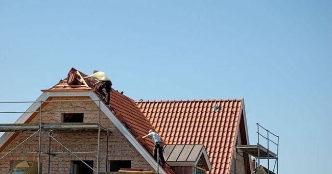 contractors repairing roof