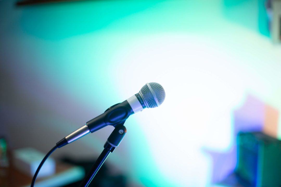 A microphone with a blurred blue background.