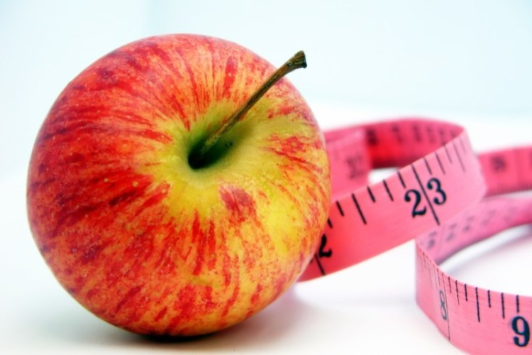 An image of an apple and tape measure