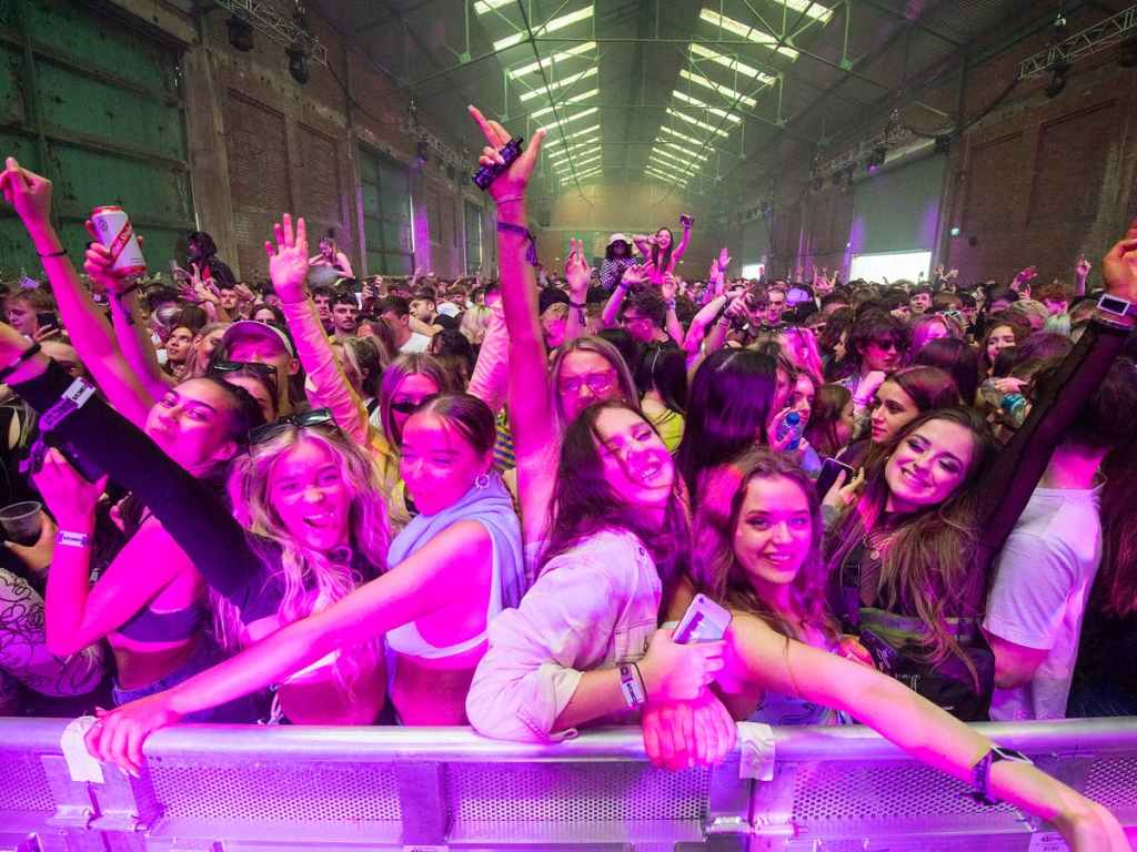 Thousands of clubbers descend on Liverpool docks for Britain's first legal rave in more than a year