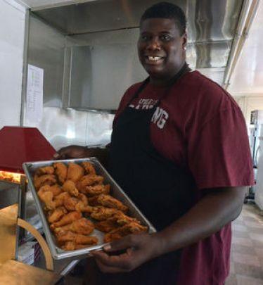 Chris Washburn serving fried chicken