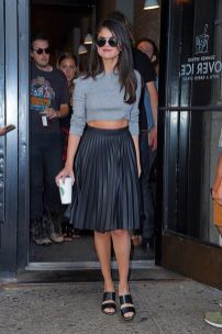 selena gomez with pleated leather skirt
