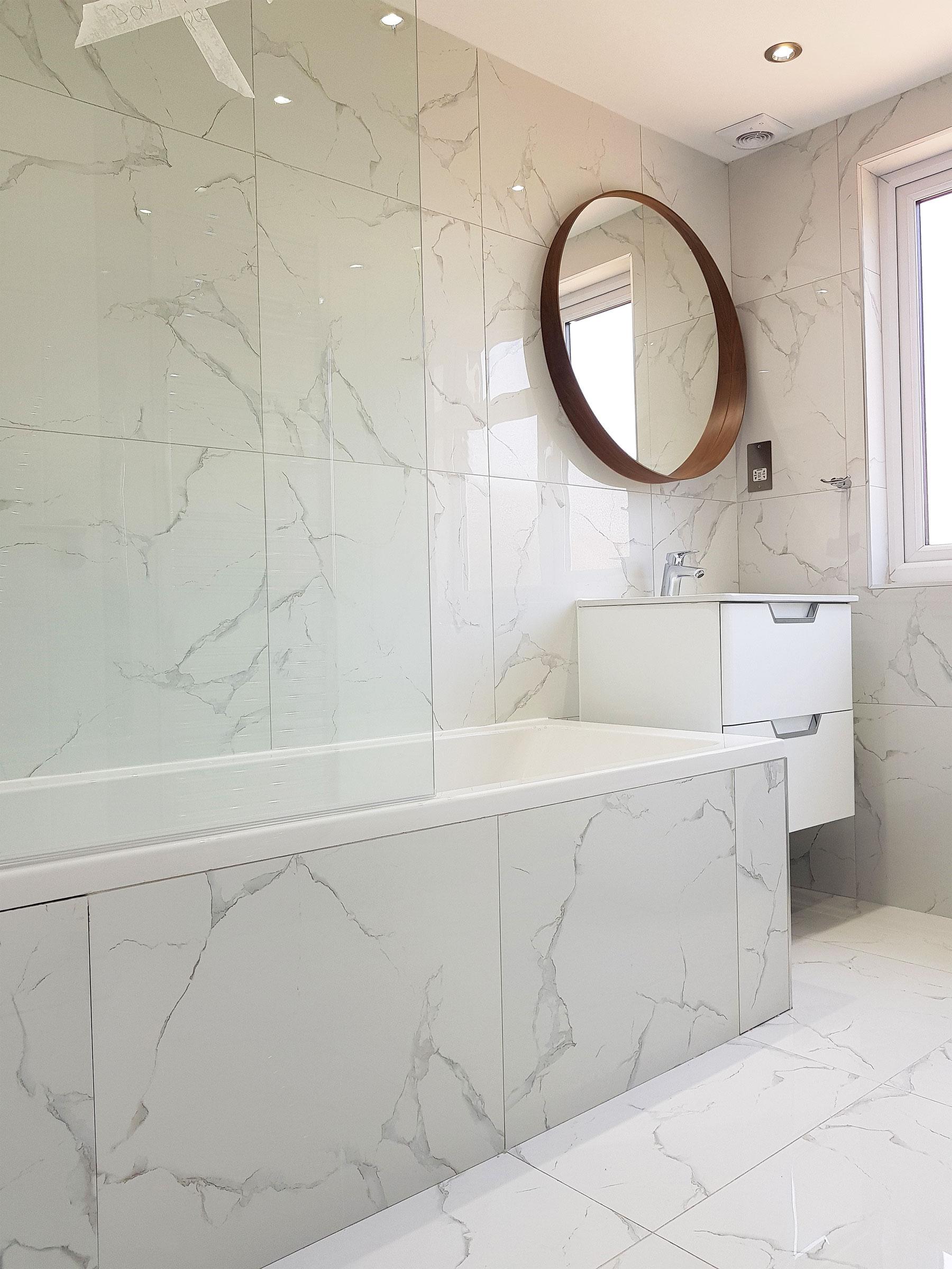 marble tile shower walls wood floor