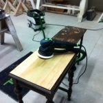sanding a table with a festool