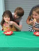Natalie Barlow being fed by Elliot Potteiger.
