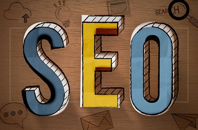 "The letters ""SEO"" on top of a board with various services icons, representing organic SEO services and how they can help your business get found online."