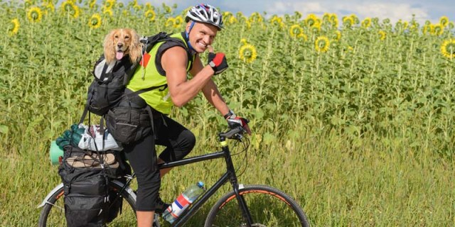 Cycling with a dog backpack carrier on the back