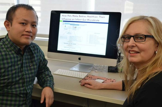 Researchers Hein Min Tun and Anita Kozyrskyj - dogs bacteria babies research