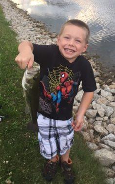 Jaydon catching a fish