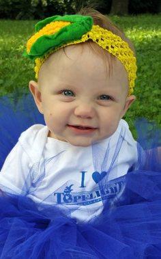 Lucy in her Topflight shirt