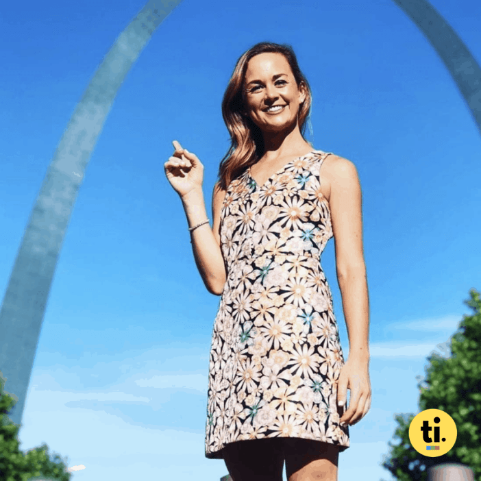 Emma Hogg, who currently reports for the KMOV in St. Louis, posing with the city's famous arches