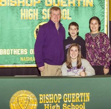 Kristin signing with family and Dad/Coach Cameron